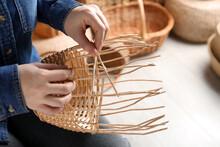 Woman Weaving Wicker Basket Indoors, Closeup View