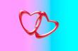 Leinwandbild Motiv Red hearts on pink-blue background