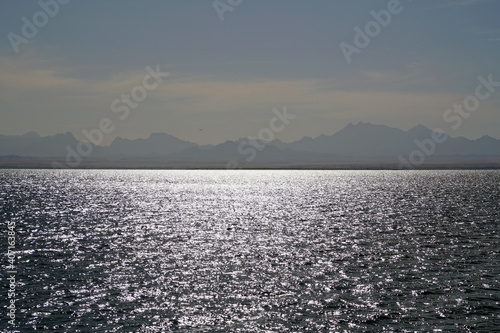 Fotografie, Obraz View from the yacht on the roadstead in the Red Sea to the mountains and the city of Hurghada