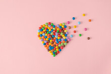 Colorful Chocolate Candy Drops In Heart Shape That Fall Apart In Pieces. Creative Love Concept.