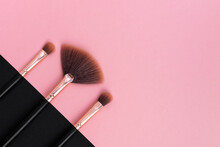 A Set Of Professional Makeup Brushes In A Row On A Pink And Dark Background. Tools For Make-up Artist In Black And Rose Gold Color. Concept Womens Cosmetics, Beauty Concept, Skin Care. Copy Space.