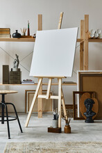 Unique Artist Workspace Interior With Wooden Easel, Bookcase, Artworks, Painting Accessories, Decoration And Elegant Personal Stuff. Modern Work Room For Artist. Template.