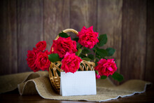 Bouquet Of Beautiful Red Roses In A Basket On Table