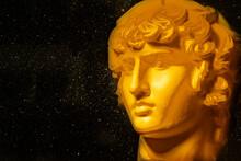 A Statue. Plaster Decorative Golden Statue Of The Head Of Apollo.
