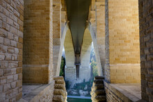 Symmetrical Pillars And Arches At The Base Of The Adolphe Bridge, Shot From The Pétrusse Park In Luxembourg City.