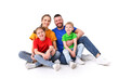 Leinwandbild Motiv family portrait. parents and children in colorful T-shirts on an isolated white background