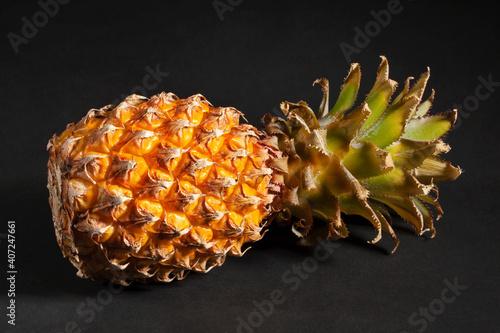 Obraz na plátně mini pineapple  on black background