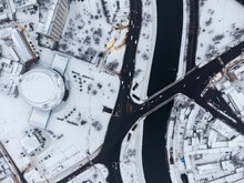 Winter Aerial View To Downtown With River Kharkov In Kharkiv, Ukraine. Round Circus Building Dome Roof Covered In White Snow. City Patterns