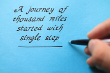 Journey Of Thousand Miles Started With Single Step, Text Words Typography Written On Blue Background, Life And Business Motivational Inspirational