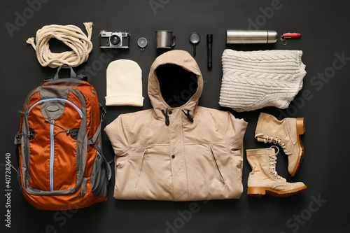Cuadros en Lienzo Set of items and clothes for hiking on dark background