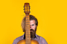 Music Is Part Of Me. Bearded Man In Checkered Shirt Sing Song. Music Performer Musician. Musical String Instrument. Mature Charismatic Male Guitarist. Guy With Beard And Moustache Play Guitar