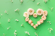 canvas print picture - Heart made of beautiful flowers on color background