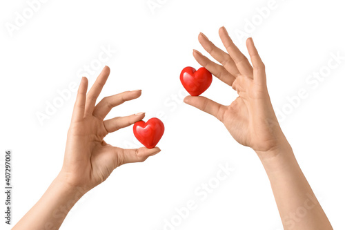 Fotomural Hands with red hearts on white background