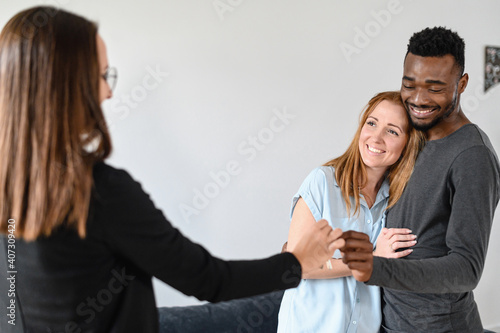 Fotografie, Obraz Happy young multiracial family buying a property