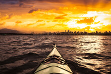 Kayaking In The Ocean With Modern City And Mountains In Background. Stormy Sunrise Colorful Sky Art Render. Taken In Jericho, Vancouver, British Columbia, Canada. Concept: Adventure, Lifestyle, Sport