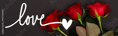 Fotografie, Obraz top view of red roses near love lettering on black, banner
