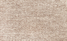 Close Up Of Beige Plain Yarn Fabric Sample For Interior Drapery Or Upholstery Work. Canvas Background.
