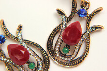 Oriental Turkish Women's Jewelry With Red Gem In The Form Of A Tulip On A White Background