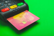 canvas print picture - Payment terminal with credit card on color background