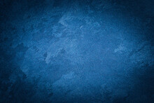 Blue Decorative Plaster Texture With Vignette. Abstract Grunge Background With Copy Space.