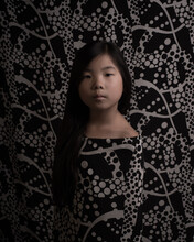 Portrait Of A Girl In Dress And Background With Black And White Geometerical Abstract Pattern
