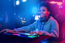 Professional Streamer African Young Woman Cyber Gamer In Neon Color Blur Background