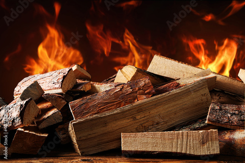 Fototapeta Dry wood and burning fire on background. Cozy atmosphere obraz
