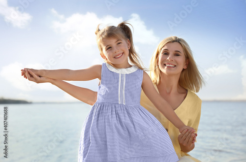 Fotografie, Obraz Happy mother and her child on beach. Spending time in nature