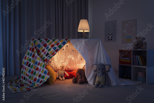 Canvas-taulu Play tent decorated with festive lights in modern child's room