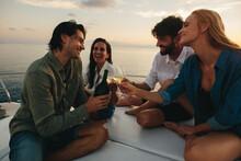 Friends Celebrating On A Yacht