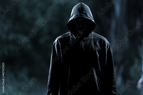 Thief in black clothes on grey background Fototapeta