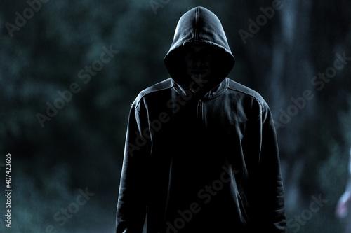 Fotografie, Obraz Thief in black clothes on grey background
