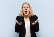 Blonde Woman Looking Desperate And Frustrated, Stressed, Unhappy And Annoyed, Shouting And Screaming