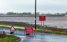 Road Ahead Closed And Flood Warning Signs On The Road To Cawood Bridge In Selby, North Yorkshire During Storm Christoph. The River Ouse Has Burst Its Banks And Water Is Flooding Into Surround Fields.