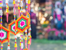 Crafting Colorful Yarn To Use Decorations For Festivals. Decorative Mobile Spider Web Weaving Hanging On A Tree. Space For Text