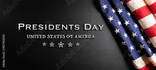 Fotografia Happy presidents day concept with flag of the United States on black wooden background
