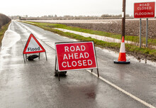 Road Ahead Closed And Flood Warning Signs On The B1222 Road To Cawood Bridge In North Yorkshire During Storm Christoph. The River Ouse Has Burst Its Banks And Water Is Flooding Into Surround Fields.
