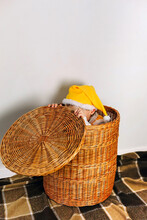 Cute Baby Boy Sit In Straw Basket And Hiding Face Under Cap, Wearing Yellow Funny Ghome Elf Hat, Family Home Fun
