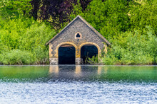 An Abandoned Boathouse On The Shore Of Cropston Reservoir In Leicestershire In Summertime