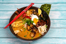 Japanese Ramen Soup With Chicken, Egg, Pork, Vegetables And Sprouts On Light Wooden Background