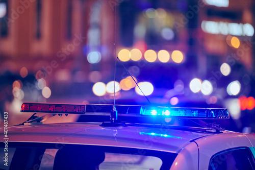 Obraz na plátně Police car lights at night city street