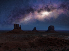 The Arch Of Milky Way In Monument Valley. Arizona Iconic Landscape At Night.