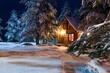 canvas print picture - Rustic log house, snow-covered pine trees, big snowdrifts, fabulous winter night