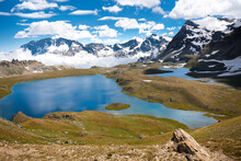 Alpine Lakes, Fields, And Mountains In The Gran Paradiso National Park