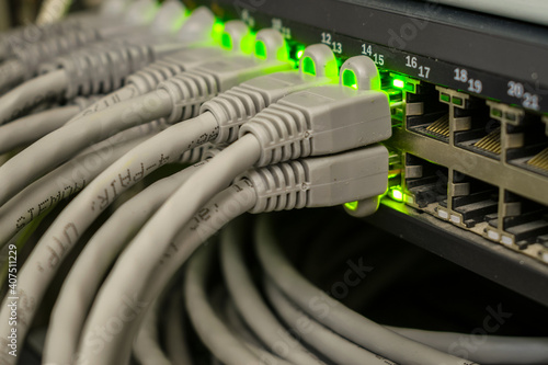 A bunch of internet wires are connected to the server switch Fototapet