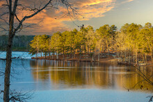 A Majestic Shot Of A Peninsula On The Lake With Vast Lush Green And Autumn Colored Trees Reflecting Off The Lake Water At Stone Mountain Park In Stone Mountain Georgia