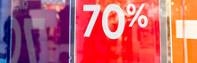 Sale Up To 70 Percent Red Sign. Red Display With Sale Up To Seventy Percent Inscription Sticked On The Store Window.Seasonal Discounts In Stores, Sale, Black Friday And Shopping Concept.