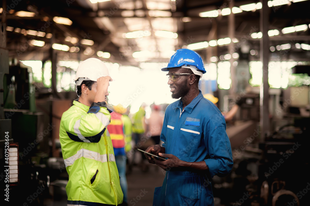 Fototapeta Group of industrial worker team and foreman  consist of Technicians, Engineers is discussing and working with many equipment and machine in Industry plant.