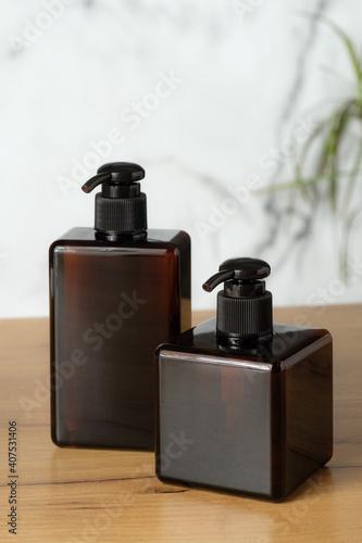 Slika na platnu Set of amber glass bottles for shampoo or soap