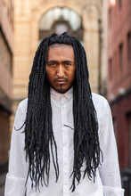 Portrait Of A Black Man With Braided Hair On The Street